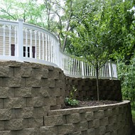 Curved rail on retaining wall